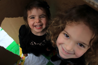 Happy New Year from Team Pop-Up Adventure Play. And the two little people in a box.