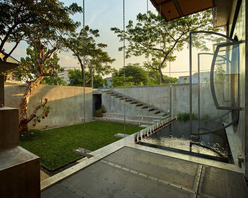 www.Tinuku.com RAW Architecture designed calm atmosphere for Omah architecture library and bookstore in Jakarta noisy