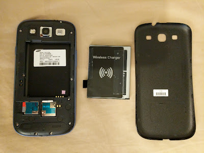 The Qi wireless receiver card module, taped to the back of the Galaxy S3 battery.