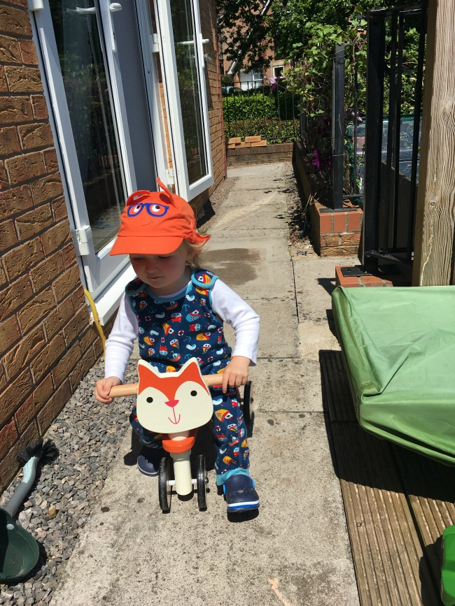 toddler-riding-bike-outside