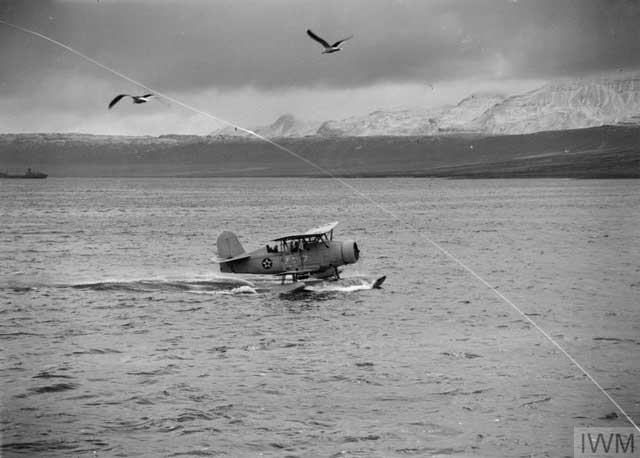 USS Curtiss Biplane, 23 January 1942 worldwartwo.filminspector.com