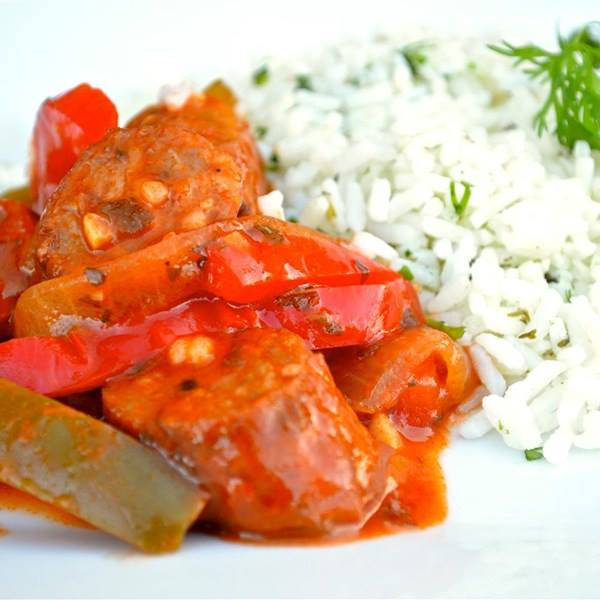 SAUSAGE WITH PEPPERS AND ONIONS SERVED WITH RICE