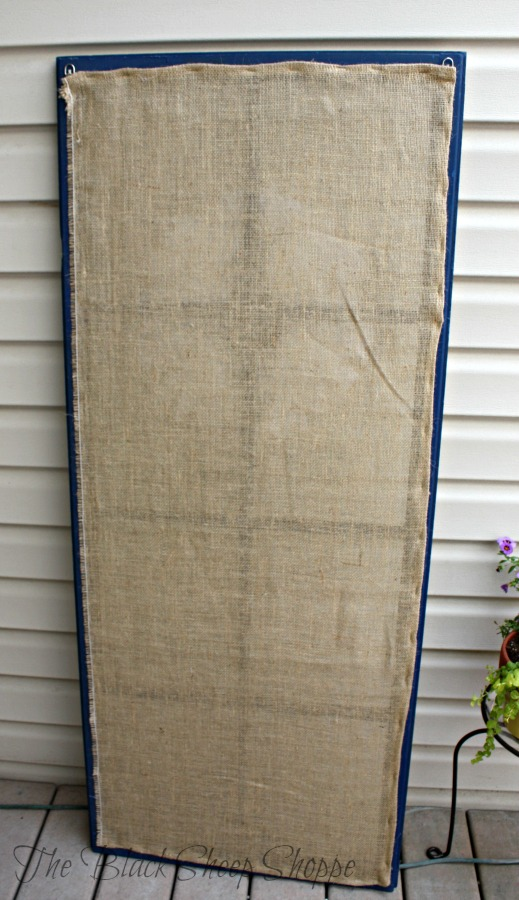 Burlap fabric was stapled to the back of the frame.