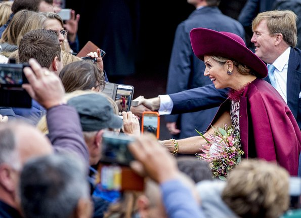 Dutch Queen Maxima wore a new Natan branded silk cape and Natan inlaid design dress.Natan suede Pumps