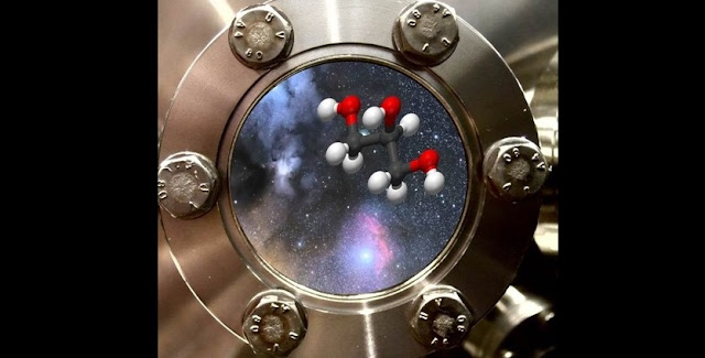 Dutch astronomers from Leiden University created the biologically important molecule of glycerol at minus 250 degrees Celsius out of only carbon monoxide and hydrogen. The photo shows a close up of the ice cold vacuum chamber containing an artist impression of glycerol and the star forming area IRAS 16293-2422. (c) Harold Linnartz