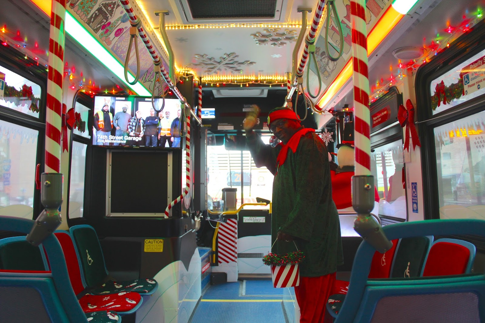 in the very back of the bus is santa and his workshop which serves as the perfect setting for the scheduled photo sessions with santa