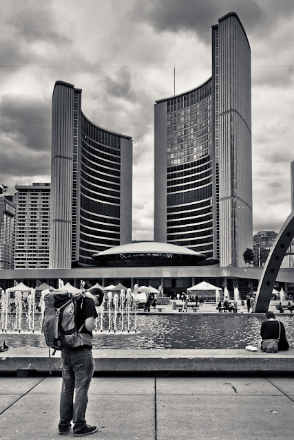Checking his bearings in front of Toronto City Hall