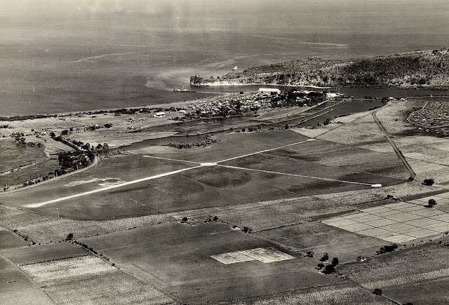 A shot of the Nasugbu Airfield with the sea in the background.  Image source:  United States National Archives.