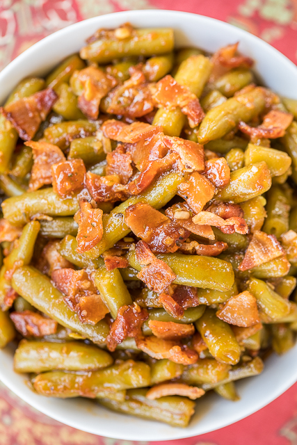 BBQ Smothered Green Beans - Smothered Green Beans - canned green beans baked in bacon, and a homemade BBQ sauce. This is the most requested green bean recipe in our house.Everybody gets seconds. SO good!! Great for a potluck. Everyone asks for the recipe! Super easy to make.