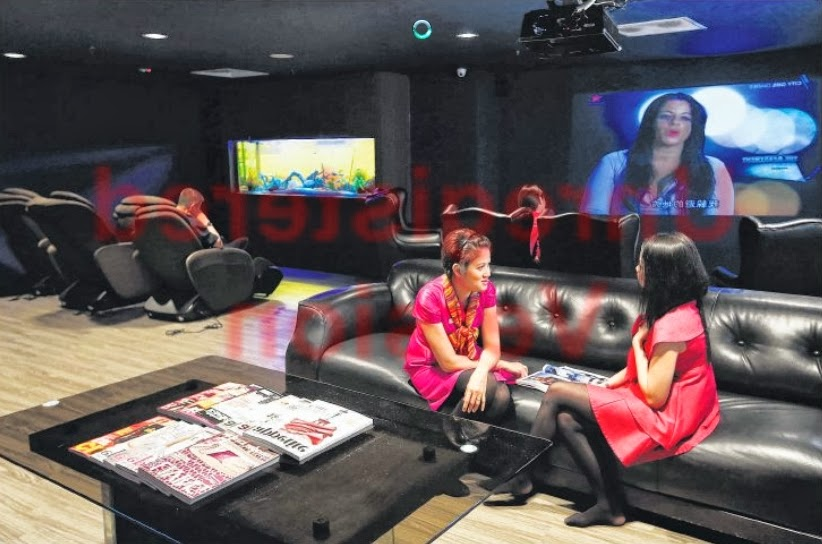 CHILL-OUT ROOM: The Chillax Lounge at the Royal Plaza on Scotts was created for staff to relax and unwind. The lounge, which opened in September last year, features massage chairs, a reading corner, a projector showing cable-TV shows and an aquarium tank.