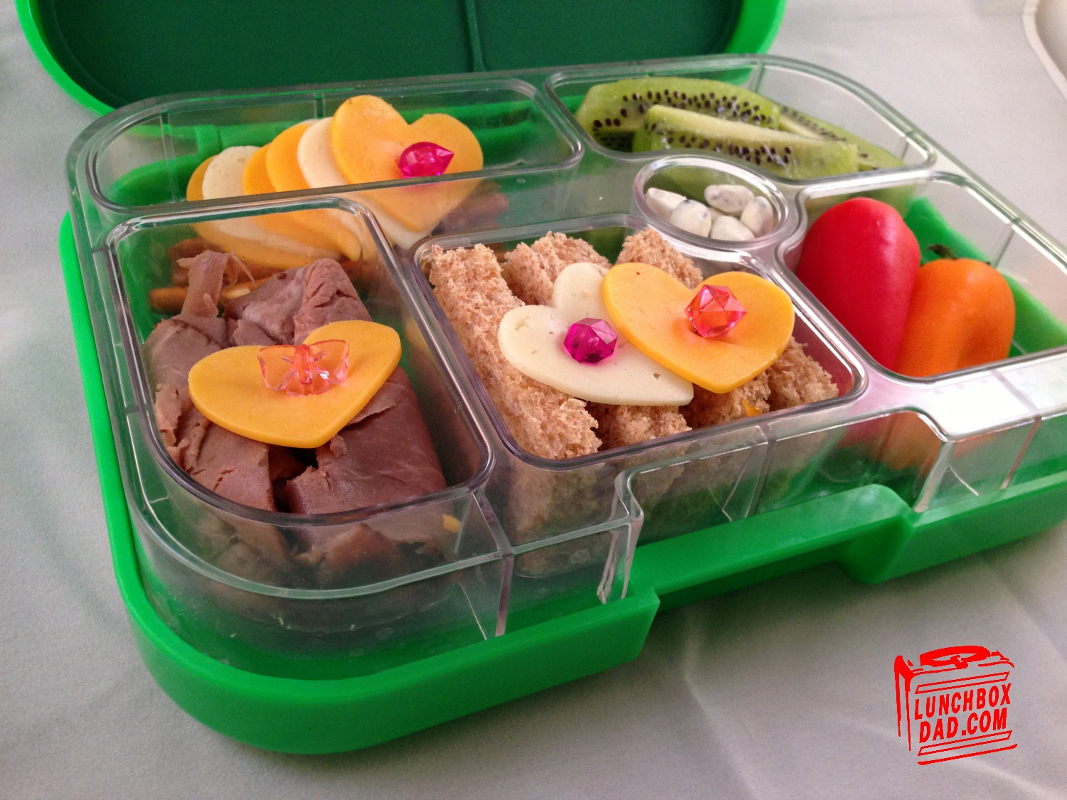 BPA-free, bento-style meal and snack containers. 3 or 4 compartments. Insulated coolers and dip containers too. Make healthy Lunchables for kids and adults.
