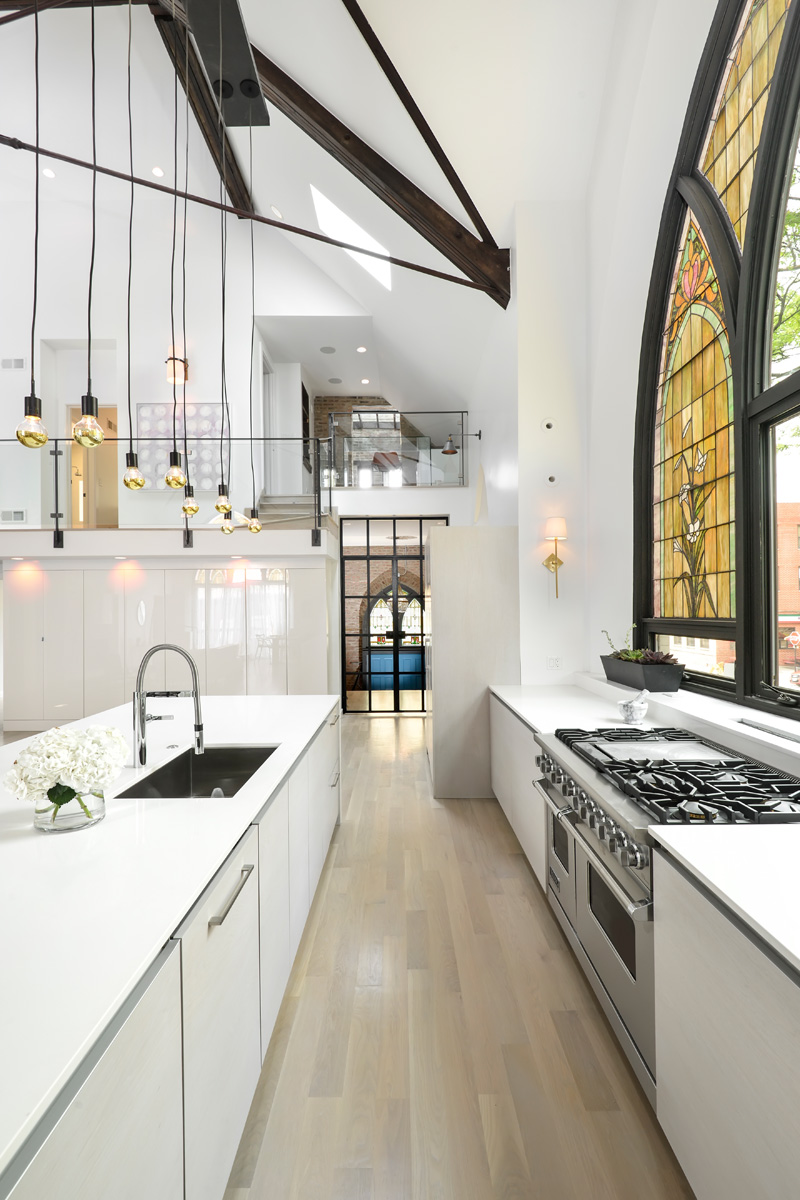 Modern white kitchen in church conversion to chic private home Chicago