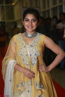 Nivetha Thamos in bright yellow dress at Ninnu Kori pre release function ~  Exclusive (9).JPG