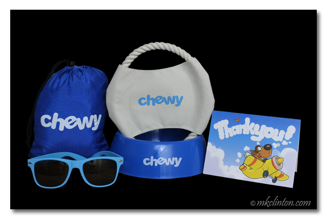 Sunglasses, dog bowl, bag, toy and card from Chewy.com