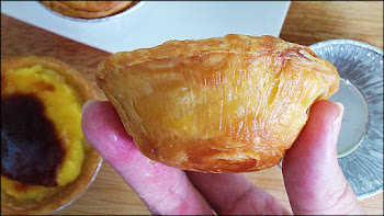 sliced portuguese egg tart showing smooth and creamy custard