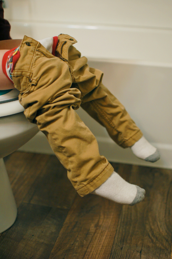 Little boy sits on toilet during a potty training.