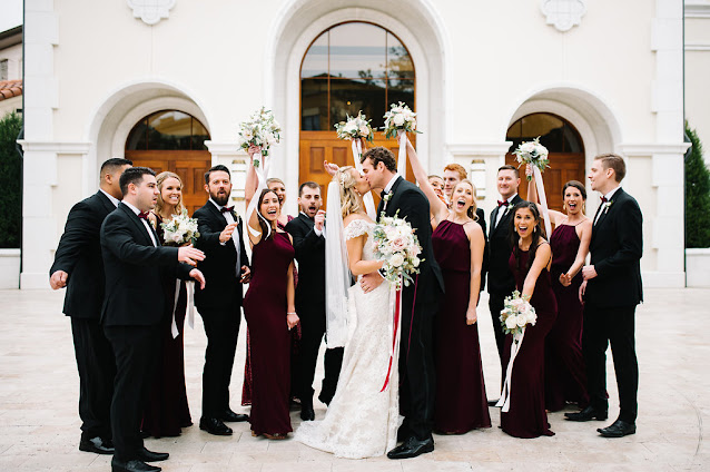 bride and groom with wedding party celebrate