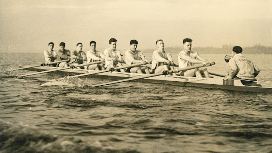 The 1936 US Olympic rowing team on the water. The unlikely crew, from the University of Washington, in a stunning upset won the gold in Nazi Germany.  Coxswain, rowing, and Other stories of Olympics. marchmatron.com