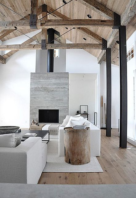 Modern farmhouse family room with exposed beams and elegant decor - found on Hello Lovely Studio