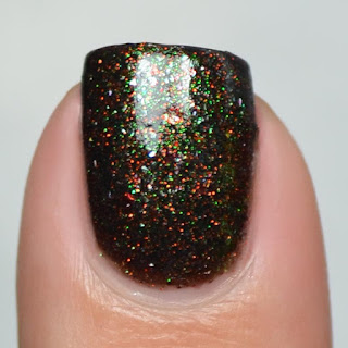 black nail polish with halloween micro glitter