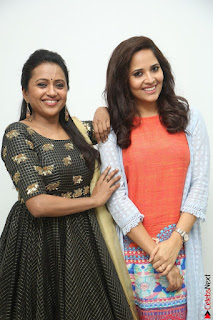 Actress Suma in Black Salwar Suit and Anusuya in orange Dress at winner movie press meet part 1 February 2017 (42).JPG