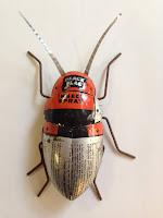 """Metal """"beetle"""" art piece by Paul Sumner."""