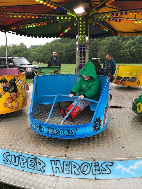 A little boy on the waltzers