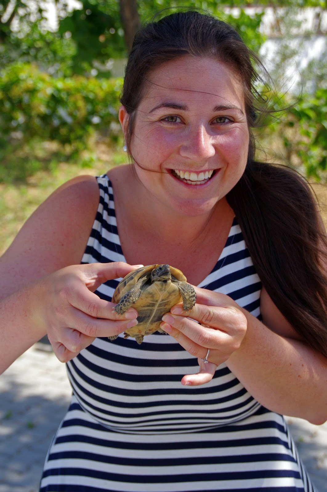 Girl with baby turtle Turkey