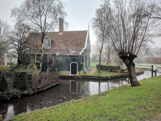 Zaanse Schans landscape: a beautiful wooden house by the river