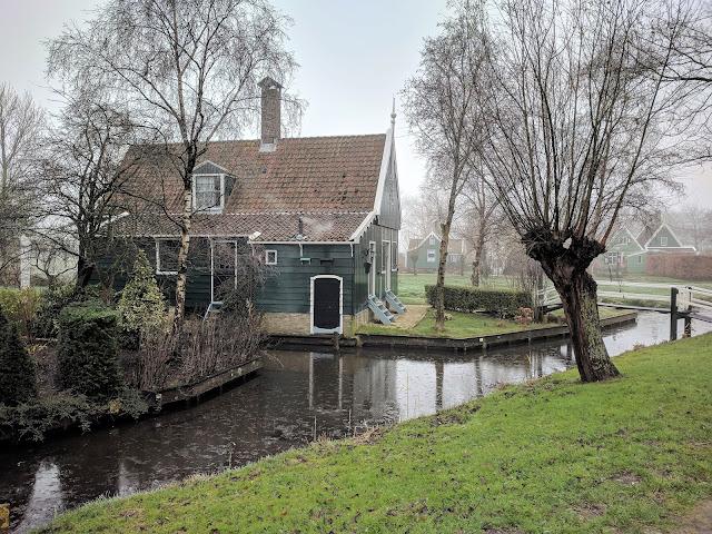 Zaanse Schans landscape: a beautiful wooden house by the river