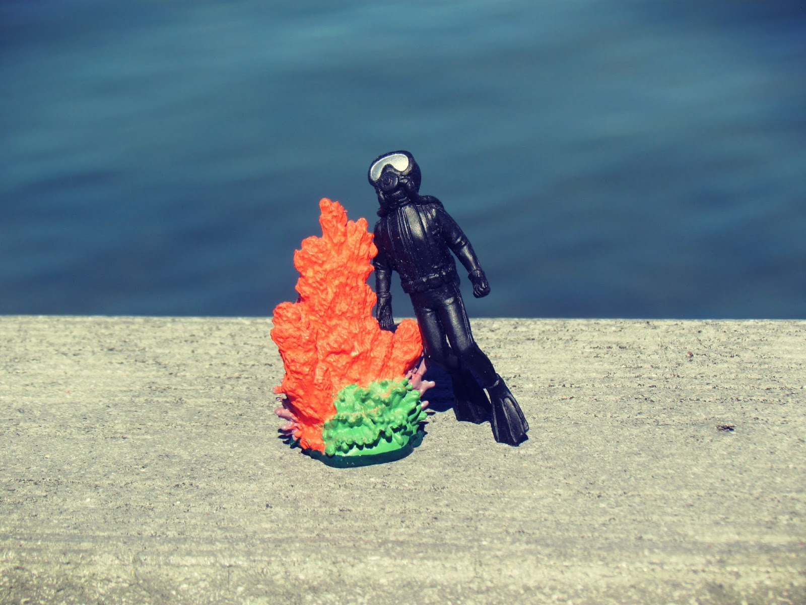 Sea Diver Tow With Plastic Fire Coral by the Ocean Blue