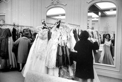 Women shopping for evening gowns at Saks Fifth Avenue in 1960