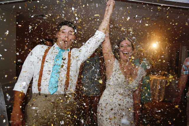 Confetti poppers at a wedding exit