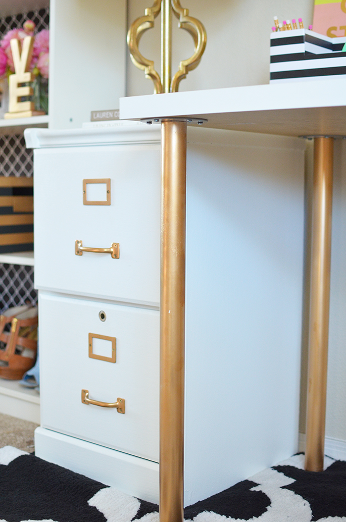 white and gold filing cabinet