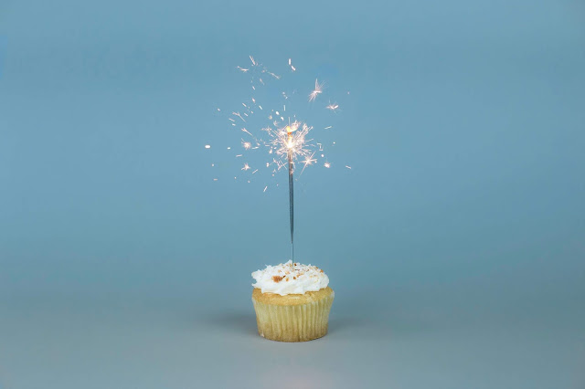 Birthday cupcake with a sparkler in the centre