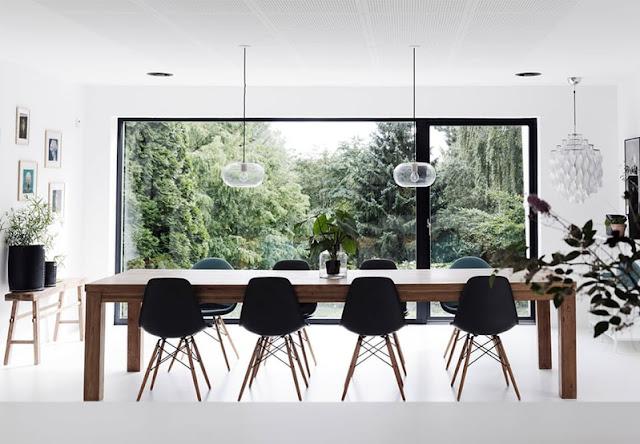 sillas eames en negro y madera