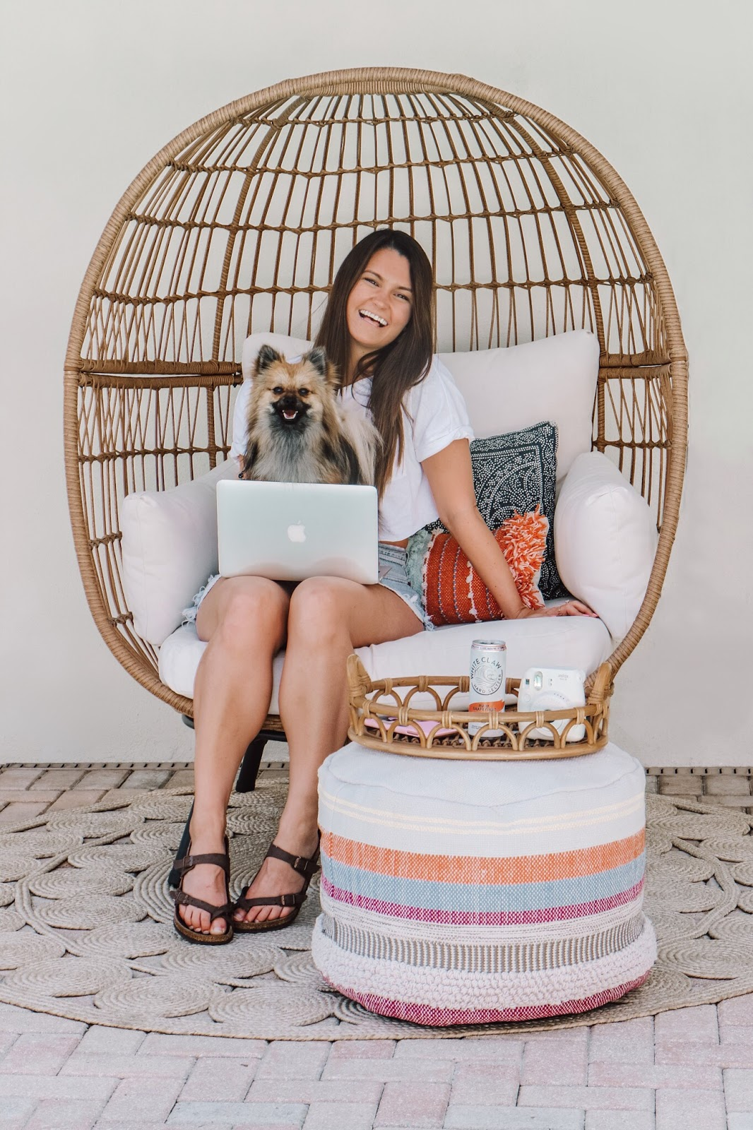 Tampa Bay Florida Blogger sitting in her egg chair on her patio answering blogging questions