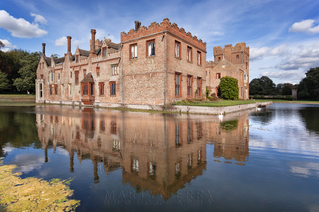 Oxburgh Hall reflection in moat on a sunny afternoon