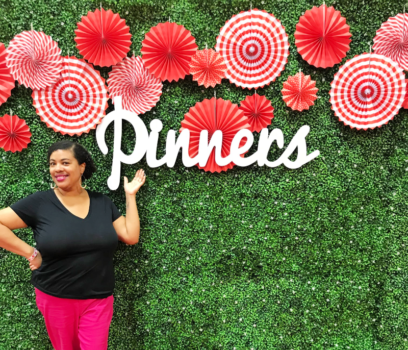 a woman standing next to the Pinners sign