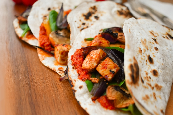 Homemade soft, warm tacos filled with a roasted pepper tapenade, salad leaves, roast spiced tofu, roast red onions and roast mushrooms. A delicious vegetarian or vegan dinner that your family will love. Includes photos and a printable recipe.
