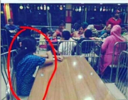 Photo of Maid Sitting By Herself As Employers Feasts Goes Viral