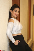 Manjusha in sleevelss crop top and black skirt at Darshakudu pre release ~  Exclusive Celebrities Galleries 039.JPG