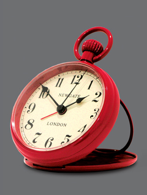red alarm clock, designed to look like a pocket watch