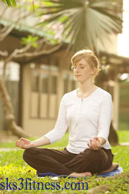 A girl meditating In Shunya Mudra / Psychic gesture of void or empty in park/garden