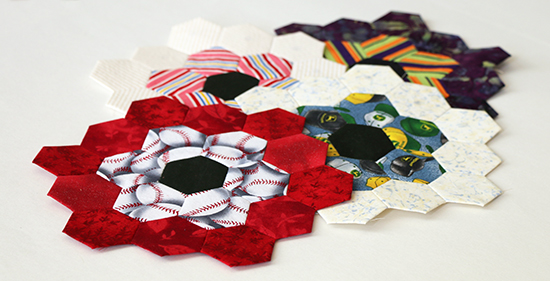4 Hand Sewn EPP Hexagon Blocks Arranged Together at an Angle