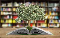money tree growing out of a book