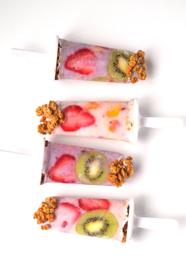 These Yogurt Parfait Popsicles make the perfect summer breakfast! Filled with yogurt, fresh fruit and whole-grain granola, they are filling and delicious! www.nutritionistreviews.com
