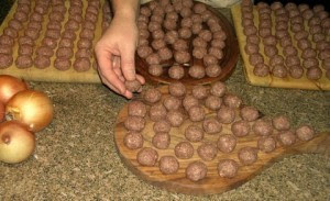 Swedish Meat Balls rolled out on cutting boards, ready to be fried.