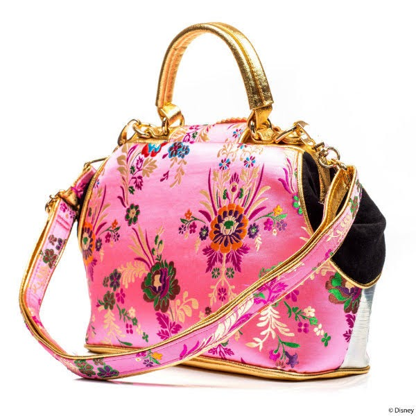 back of pink floral handbag with long strap and black sides and gold detailing