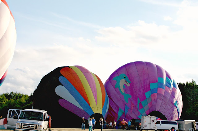 Inflating hot air balloons at Balloonfest in Waterford, WI